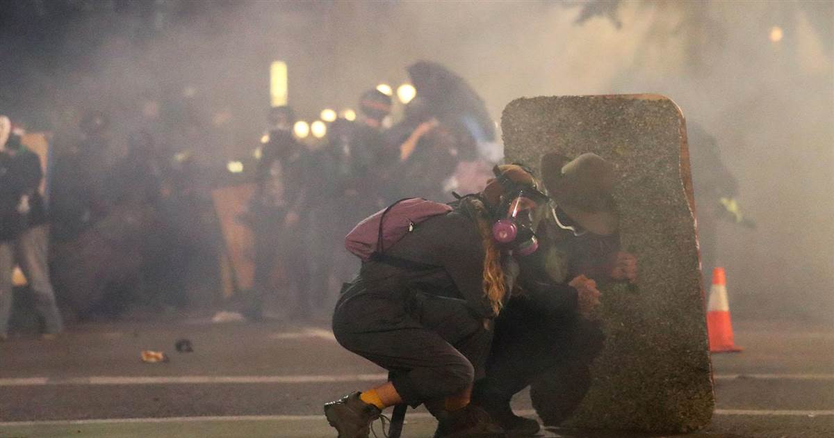Tear gas, flash-bangs and fireworks thrown on another violent night in Portland