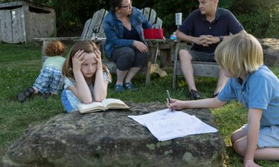 Parents and students learning from home outside