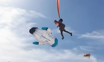 A 3-year-old girl lifted super high into the air by a kite
