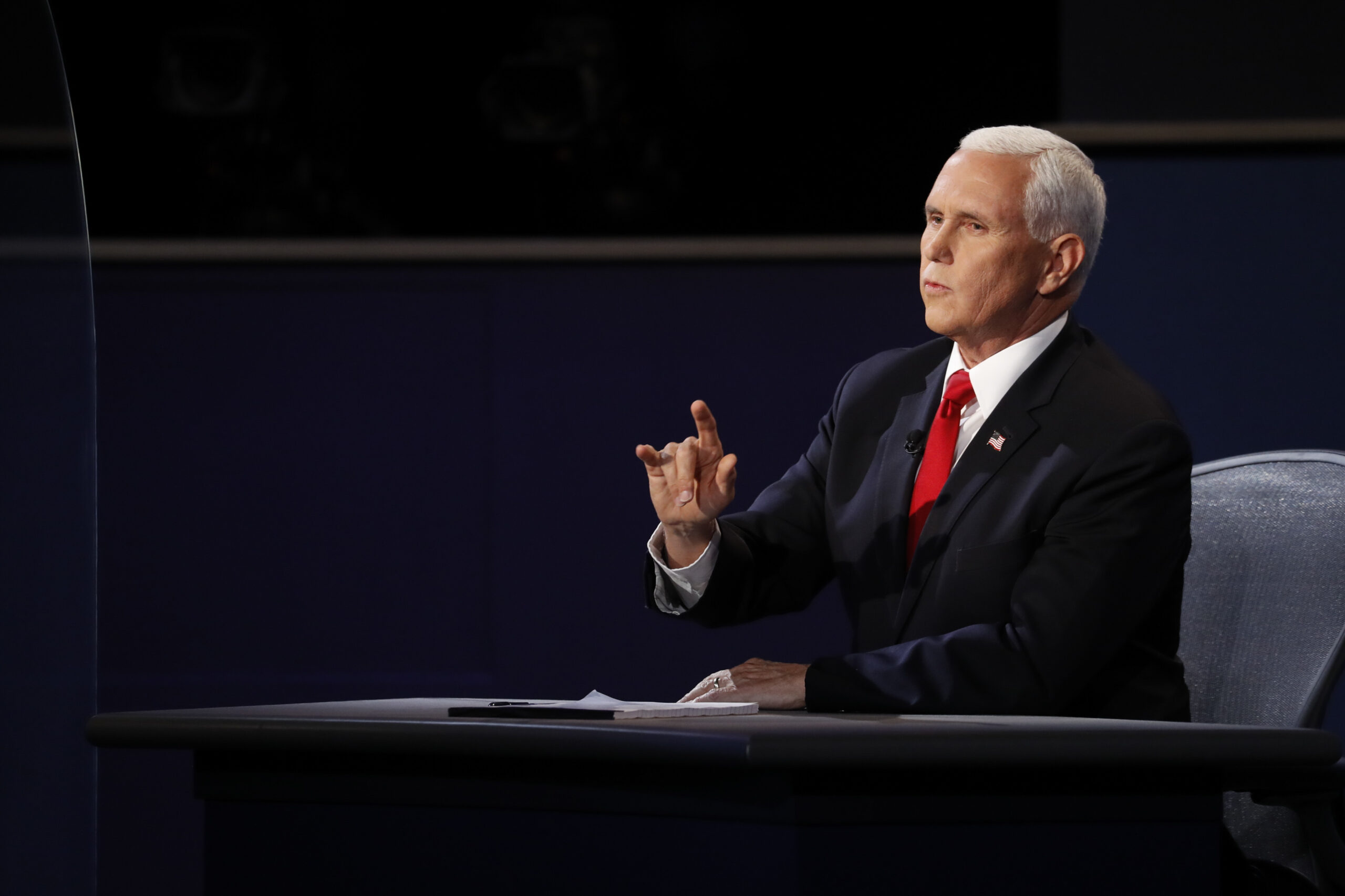 Mike Pence, head of the coronavirus task force, struggles to answer questions during debate