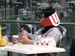 Woman wears KFC box as face mask at Westfield Marion in South Australia to protect from coronavirus