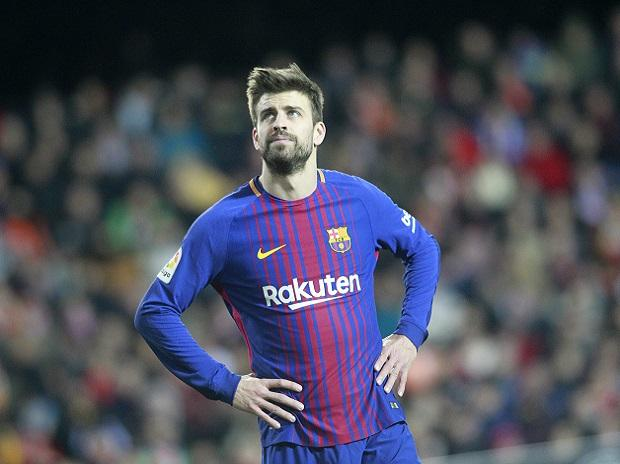 Barcelona's Pique likely out for several months because of knee injury