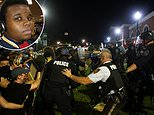 Police clash with protesters in Ferguson and Phoenix on sixth anniversary of Michael Brown's death