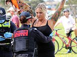 Anti-lockdown protesters swarm suburban park after being turned away from Melbourne's city centre
