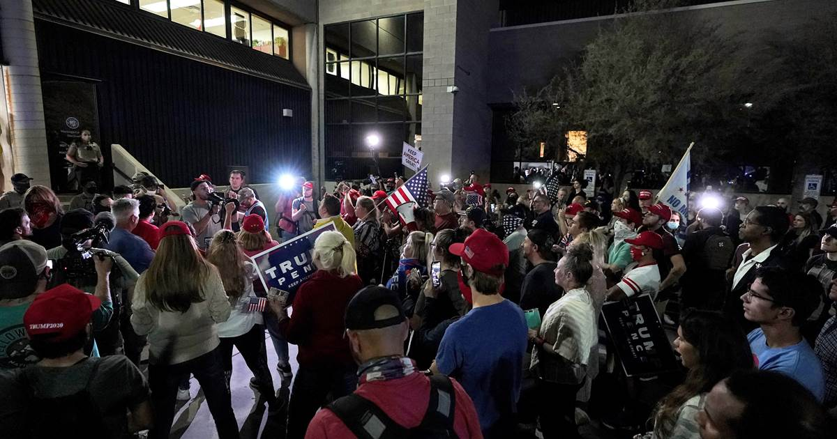 Chanting 'count the votes,' pro-Trump protesters gather outside Arizona counting center