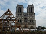 French carpenters raise a wooden truss as they rebuild Notre Dame using 800-year-old techniques