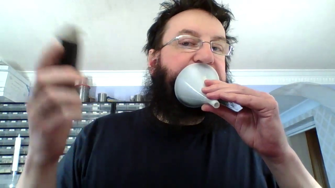 Guy shows us how to shave the perfect goatee using a funnel