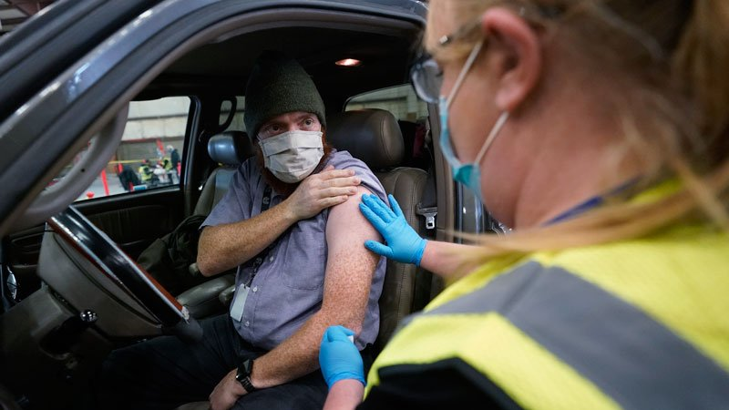 Want a Vaccine With That? Drive-Thru COVID Shots Recommended