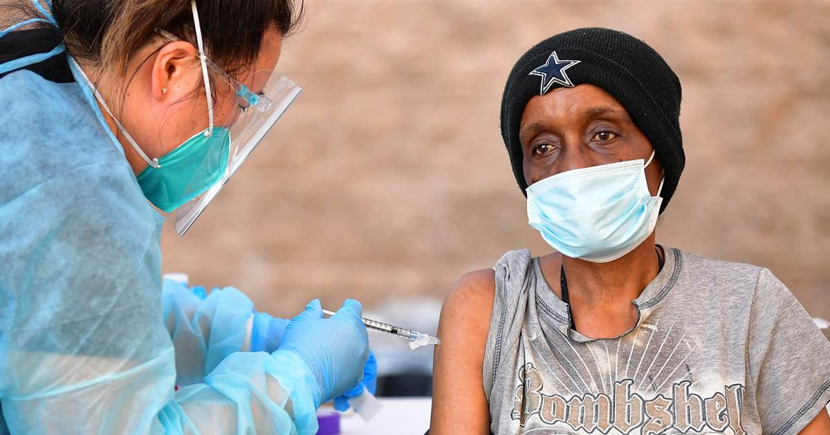 Homeless Americans fear vaccine conspiracies. Here's how cities are intervening.