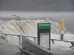Huge Sydney river breaks its banks causing wild flooding as towns are hammered with 300mm downpour