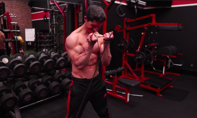 These 10 Resistance Band Exercises Can Help You Build Bigger Biceps