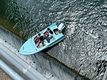 Boat full of revelers nearly slips over DAM in Texas before being rescued