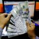 Powell presses pause on dollar's rally; sterling surging