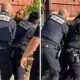 Disturbing moment three DC cops punch black man armed with illegal gun 12 times during arrest