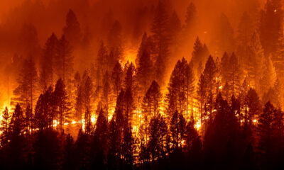 Western fires threaten thousands of homes, strain resources