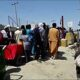 Desperate enough to risk their lives: Afghans trying to flee Kabul return to airport