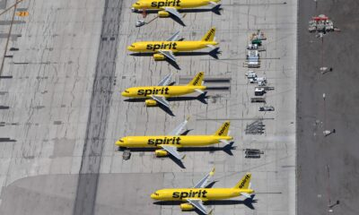 Spirit Airlines accused two ex-employees of conspiring with a supplier that it claims hugely inflated prices and gave kickbacks to the workers