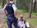 Little girl sits in her handcuffed father's lap after he is arrested in Sydney Covid hotspot
