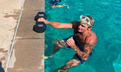 Watch Surfing Legend Laird Hamilton Swim Laps While Carrying a Dumbbell