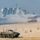 Vladimir Putin oversees huge military exercises within striking distance of Europe