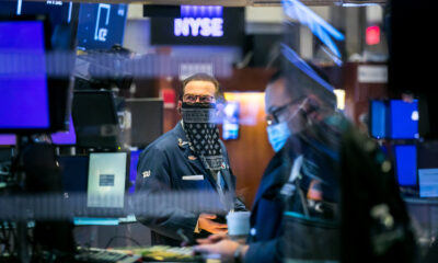 Stock futures edge lower to start the week
