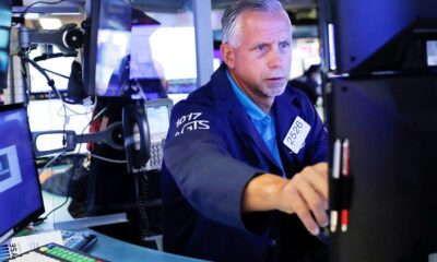 Dow futures jump more than 200 points on stellar earnings, surprise retail sales increase