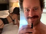 Armie Hammer shows off lingerie-clad woman waiting on all fours on his bed